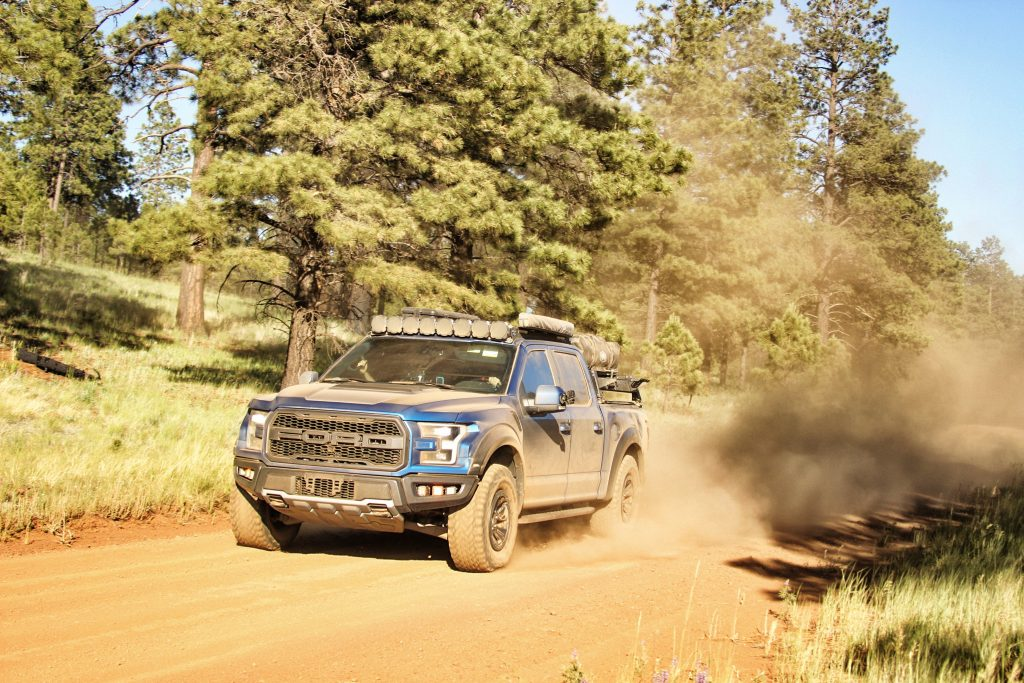 2018 Ford Raptor kicking up dirt