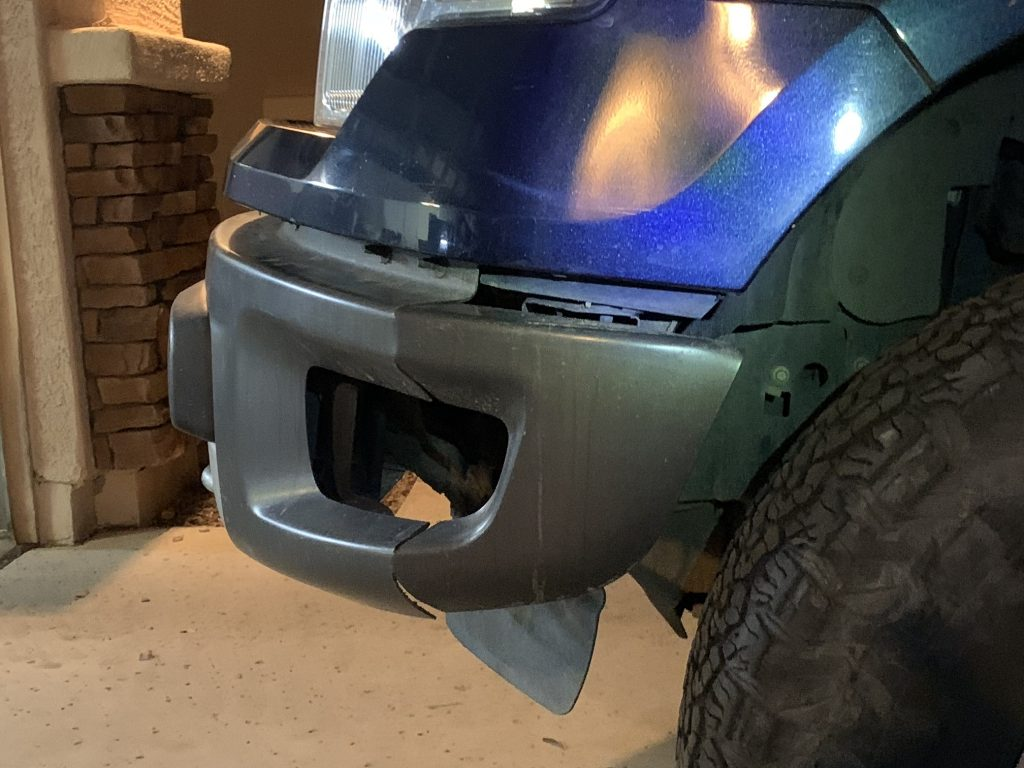 Side view of F150 raptor bumper swap after cutting