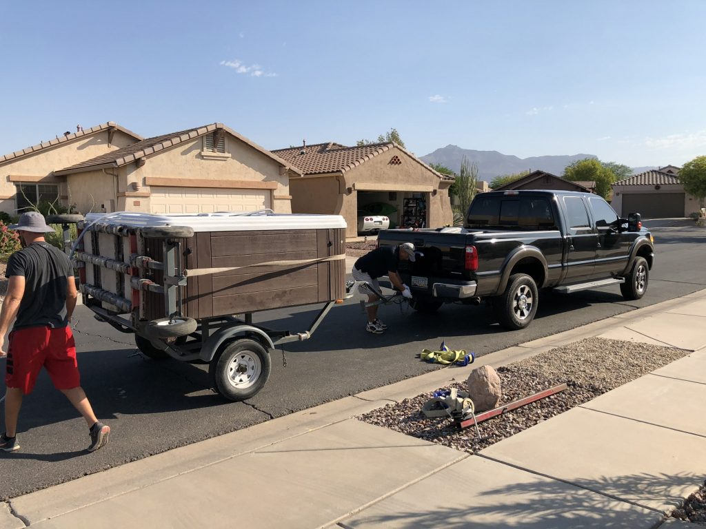 Hot tub on trailer behind truck