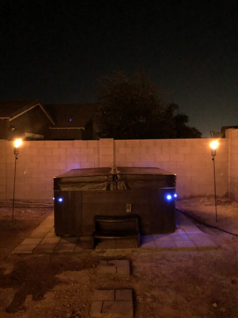 Hot tub with blue LED lights and Tiki torches