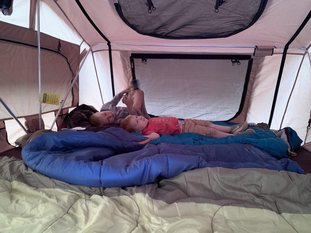 Two boys inside Smittybilt Overlander XL roof top tent