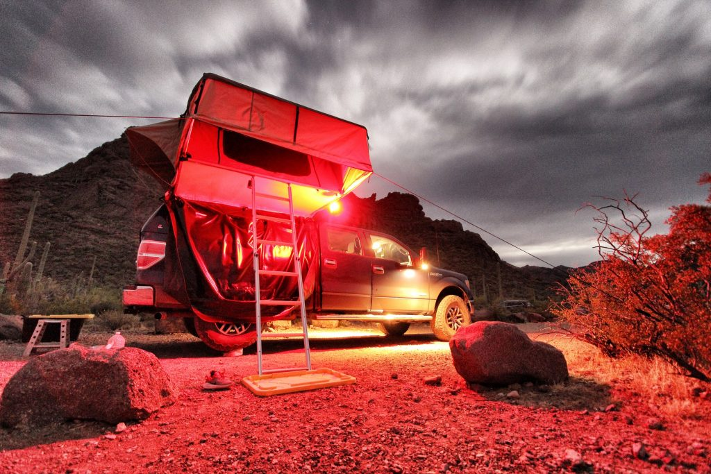 Night photo of Overland setup at Organ Pipe Cactus National Monument. 2014 F150 with Raptor wheels and 35in tires