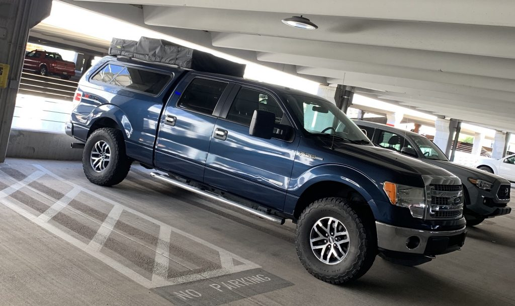 2014 F150 with Smittybilt roof top tent inside parking structure