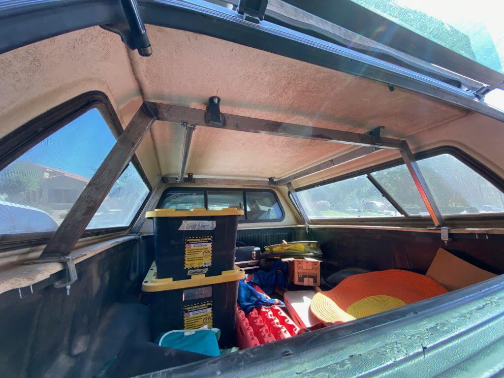Steel tube structure reinforcement for fiberglass truck bed camper topper shell