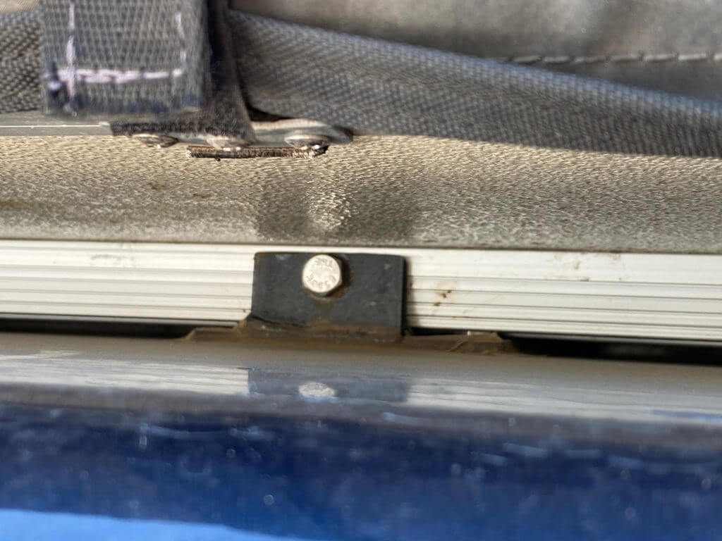 Tent mounting bolt through tent rail and reinforcement structure